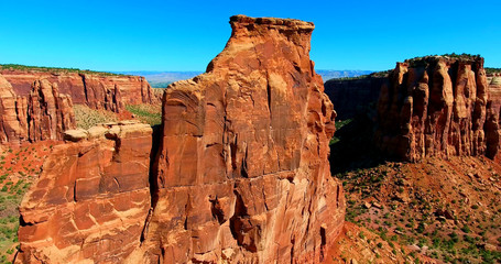 Steep Red Butte Against Blue Sky In Desert Landscape - Colorado National Monument, USA