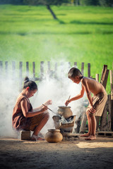 Asian children boy and girl are cooking in the Kitchen of the Countryside of Thailand, living in countryside, Countryside Thailand.