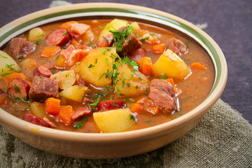 Tasty stew. Goulash soup bograch in a bowl. Hungarian dish, horizontal