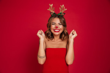 Portrait of an excited smiling girl wearing christmas deer costume