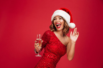 Portrait of a cheerful laughing woman in christmas hat