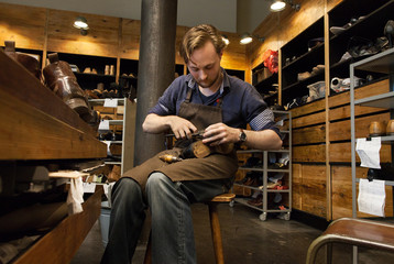Shoemaker in Wooden Workshop