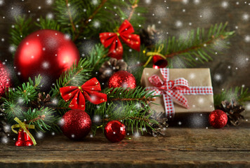 Happy New Year - a holiday background with fir, balls, cones on the wooden background
