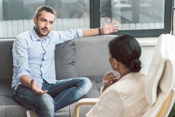 Embarrassed male visitor of psychotherapist