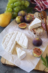 Camembert cheese, figs, fruits and bread