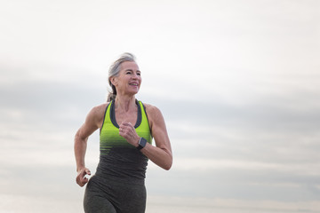 Active senior woman running