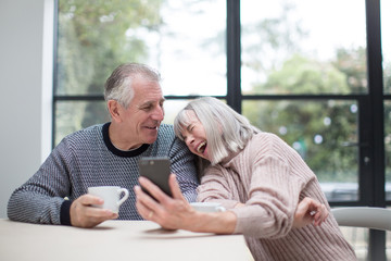 Senior couple using a smartphone together