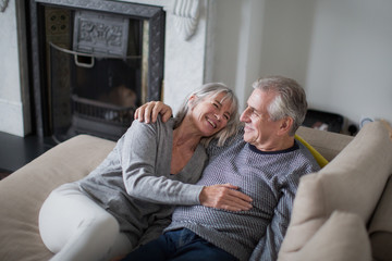 Senior couple relaxing on sofa