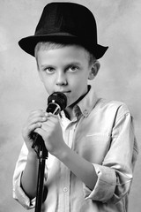 Portrait of a boy with a microphone