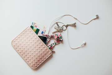 Overhead view of women's purse with personal accessories