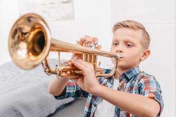 boy practicing trumpet Wall mural