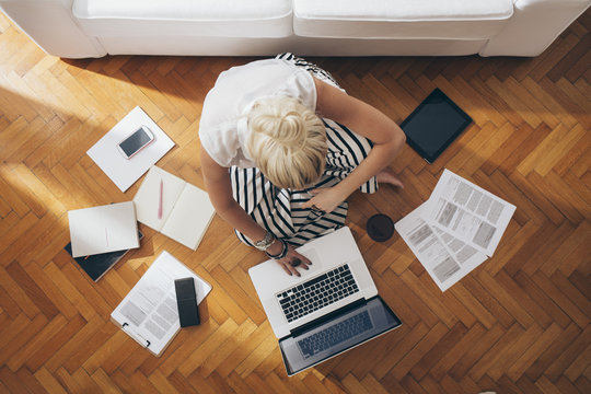 Businesswoman Sitting on the Floor and Working