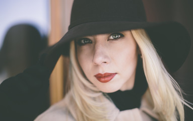 young blond woman with hat