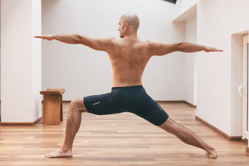 Yoga - Man in Warrior II Pose - Virabhadrasana