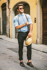 Handsome Man with a Vintage Denim Shirt Exploring an Old Italian Town