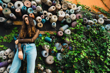 Woman at wall with rolls