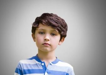 Boy against grey background pondering