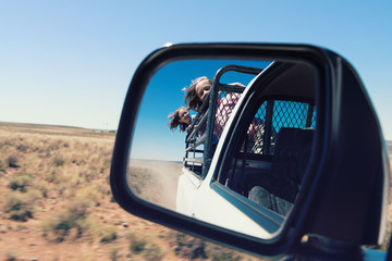 girls in a bakkie, or ute, or pick up truck, on a farm in rural South Africa