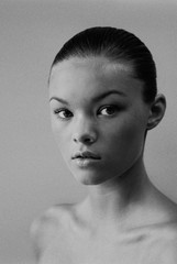 black and white headshot of a young woman
