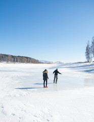 Couple skating on the frozen lake
