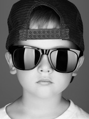 funny child.little boy in sunglasses