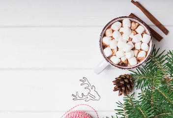 Hot cocoa with marshmallows in the cup on the white background