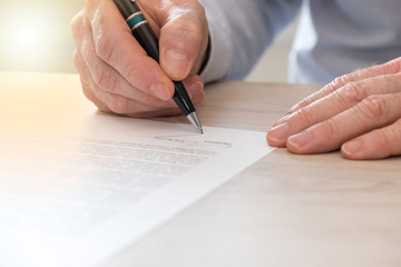 Man signing a contract, light effect