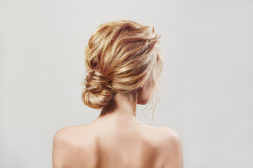 Back view of blondi woman with long hair