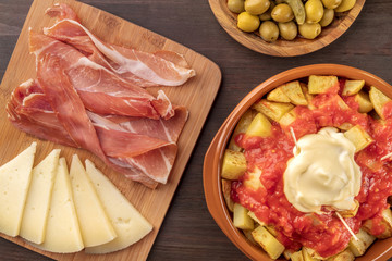Patatas bravas, olives, jamon, cheese. Spanish tapas