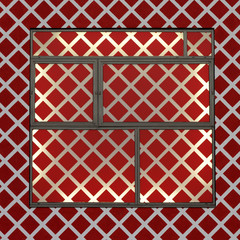 Red diagonal square patterned front of a commercial building. Interior illuminated by sunlight