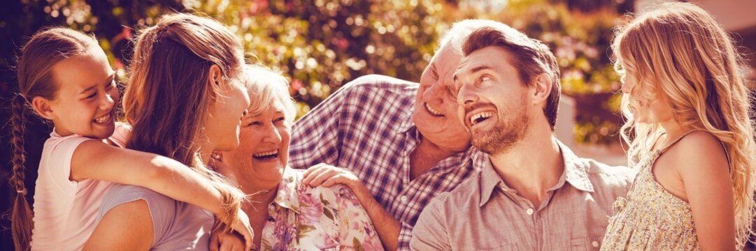Family laughing in back yard