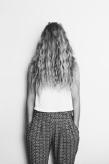 Girl hides her face behind her long hair