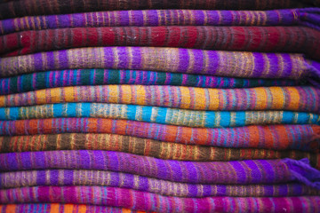 Background of colorful warm winter clothes.