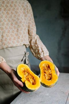 Woman holding a fresh Pumpkin