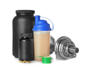 Jars with bottle of protein shake and dumbbell on white background