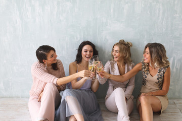Crazy party time of four beautiful stylish women in elegant casual outfit celebrating new year, birthday , having fun, dancing,drinking alcohol cocktails .