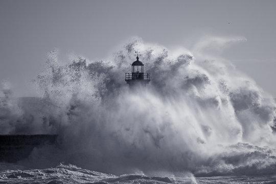 Od lighthouse embraced by stormy waves