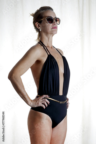 7bc465eda1c Approximately 50 year old woman in a beach swimsuit