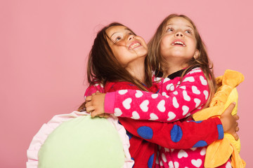 Kids look up and stand on pink background