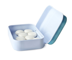 Open box with hard mint candies on white background