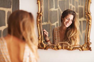 beautiful Peruvian woman smiling in a mirror