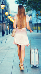 Young traveling woman going  to the historic city center