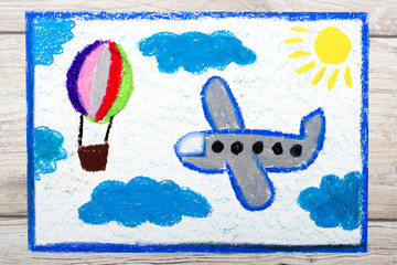 Photo of colorful drawing: Small blue airplane and hot air balloon