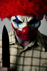 scary evil clown with a big knife