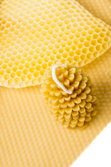 Candle made of beeswax  on a beeswax comb