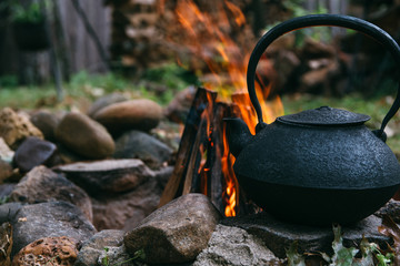 Cast Iron Kettle By A Camping Fire