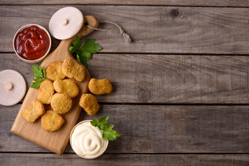 Chicken nuggets on wooden background