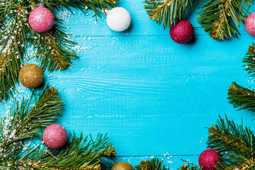 Photo on top of Christmas table with spruce branches and colorful balls