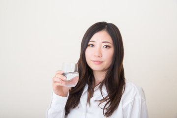 young asian woman with glass of water