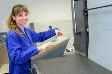 Woman programming electronic machine